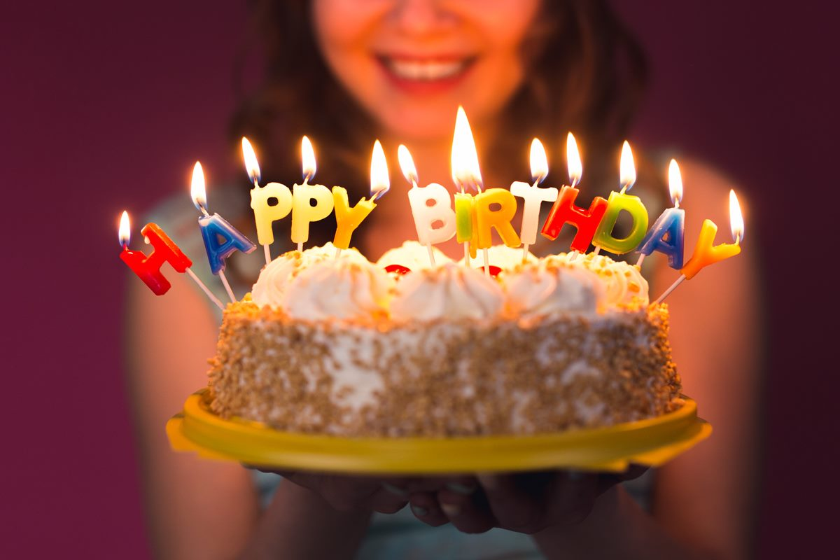 hands-of-young-woman-holding-birthday-cake-PAXNLTX (Copy)